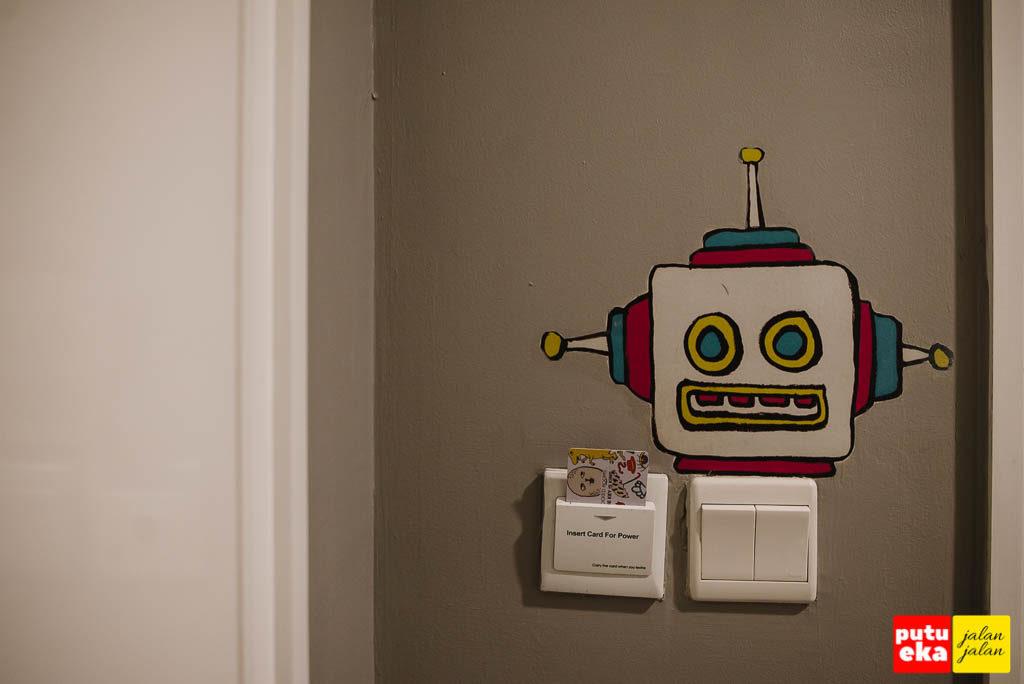 Tempat kartu untuk menyalakan kelistrikan yang dipermanis dengan kartun robot