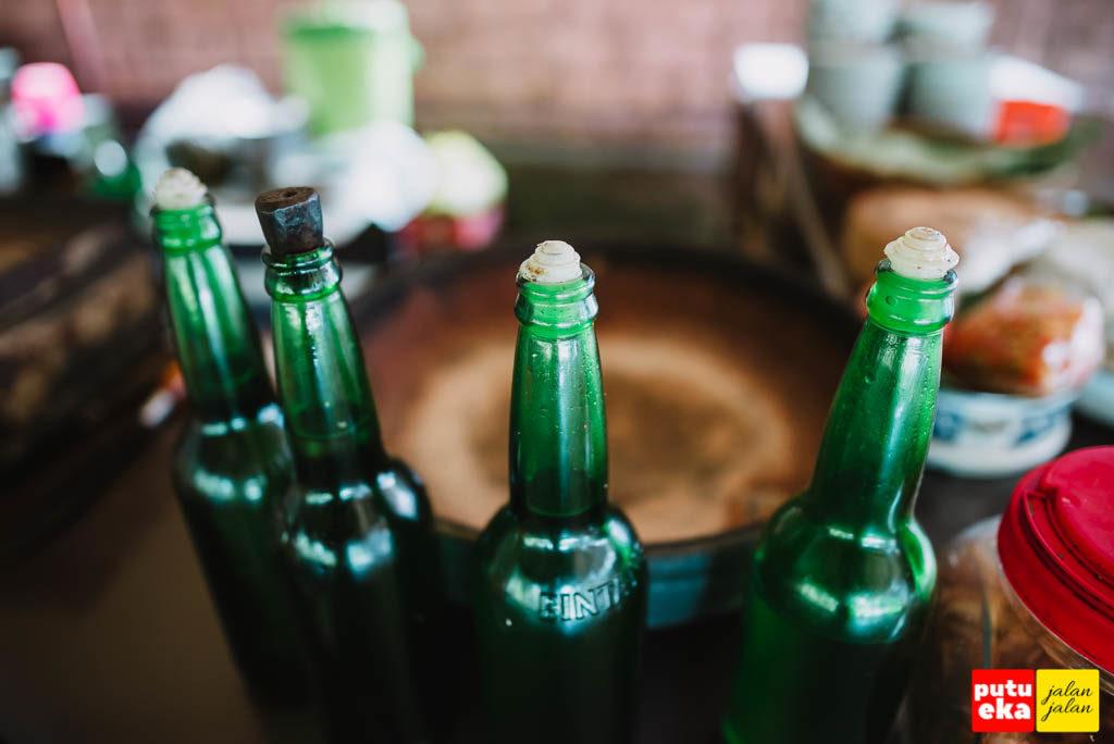 Botol hijau tempat minyak kelapa asli